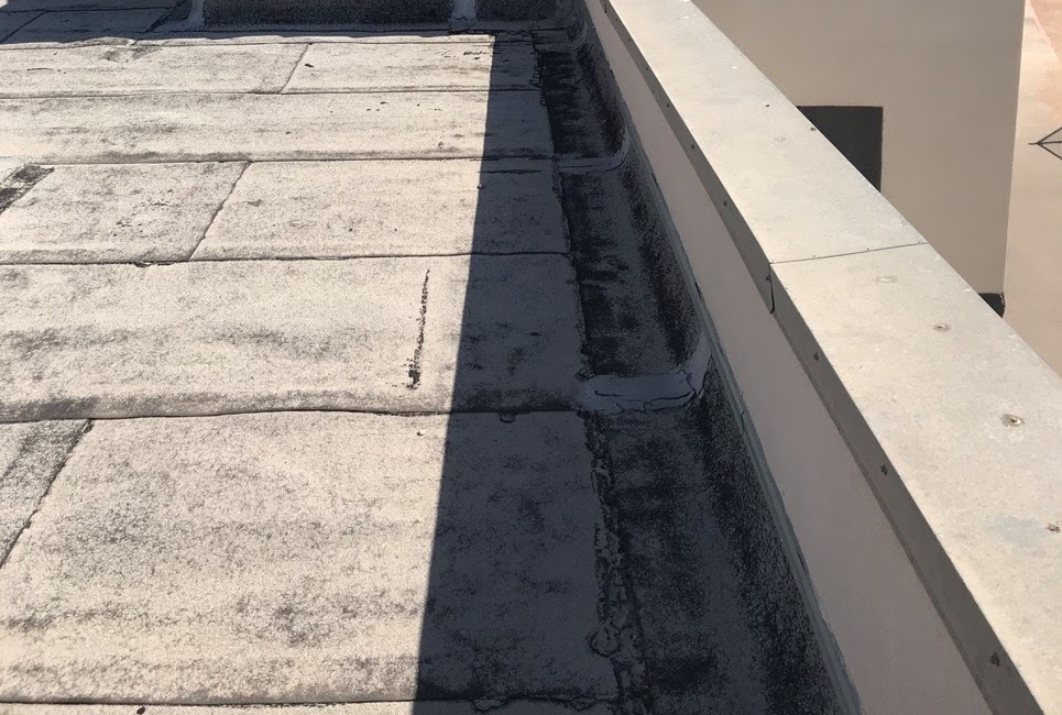a roof coating completion on a flat roof